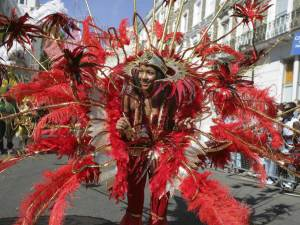 Notting Hill Carnival participant wearing a spectacular red and gold feathered costume, Notting Hill, London © VisitBritain / Jon Spaull Source:© VisitBritain / Jon Spaull