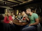 A group of young friends enjoying a drink in the pub Source:© Britainonview / Simon Winnall