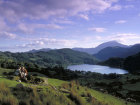 Couple On Mountain Overlooking Lake, Snowdonia, Gwynedd, Wales © Britainonview / - Britain on View
