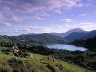 Couple On Mountain Overlooking Lake, Snowdonia, Gwynedd, Wales © Britainonview / - Britain on View