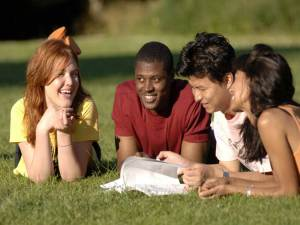 Group of friends studying and socialising outdoors at summertime © Britainonview / Eric Nathan