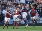 Luke Young (C) celebrates with team players after scoring the first goal for Aston Villa Source:Action Images / Andrew Boyers