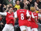 Robin Van Persie (L) - Arsenal celebrates after scoring Source:Action Images / Andrew Couldridge