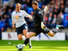 Bolton's Kevin Davies (L) in action with Birmingham's Ben Foster Source:Action Images / Jason Cairnduff