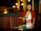 A happy young woman enjoying a cocktail at Bar Soho in London © Britainonview / Simon Winnall Source:VBimages - 22441669